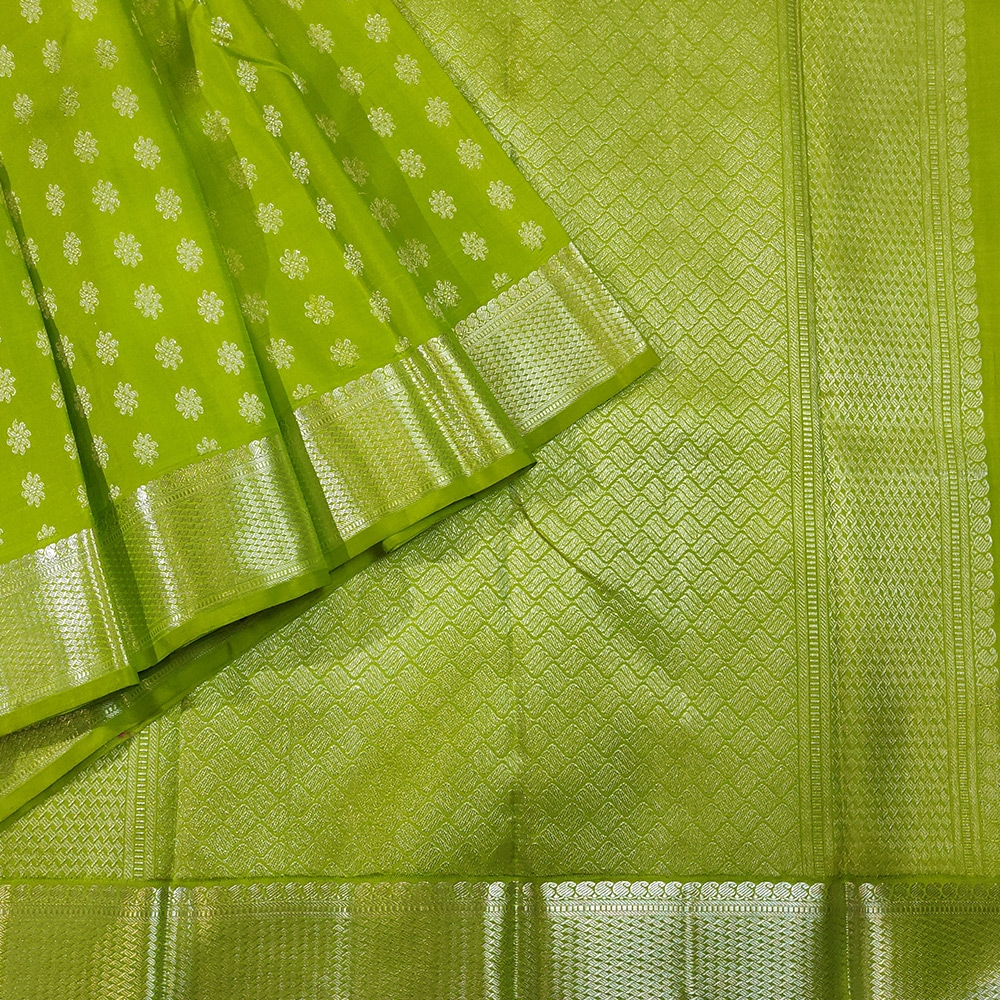 Lime green Kanchipuram silk saree with flower zari designs-0